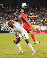 KANSAS CITY, KS - JUNE 26: Cristian Roldan #15 heads the ball over Jose Rodriguez #7 during a game between Panama and USMNT at Children's Mercy Park on June 26, 2019 in Kansas City, Kansas.