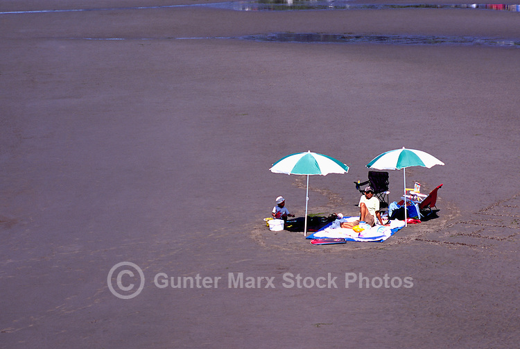 Summer Recreational Activities at White Rock, BC, British Columbia, Canada - Father and Child sunbathing on Sandy Beach along Semiahmoo Bay