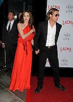 "20 September 2016 - Los Angeles, CA - Angelina Jolie Pitt has filed for divorce from Brad Pitt. Jolie Pitt, 41, filed legal docs Monday citing irreconcilable differences. Jolie Pitt requested physical custody of the couple's shared six children – Maddox, Pax, Zahara, Shiloh, Vivienne, and Knox – asking for Pitt to be granted visitation, citing legal documents. File Photo: 24 May 2011 - Los Angeles, California - Angelina Jolie and Brad Pitt. ""The Tree of Life"" Los Angeles Premiere held at the LACMA Bing Theatre. Photo Credit: Byron Purvis/AdMedia"