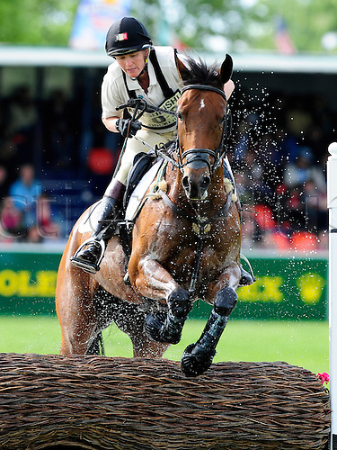 2009 Mitsubishi Motors Badminton Horse Trials.Baminton UK.The Cross country phase:.Karin Donckers (BEL) riding Gazelle Della Brasserie.At the lake complex.The 3 day event was won by Oliver Townend (GBR) riding Flint Curtis..