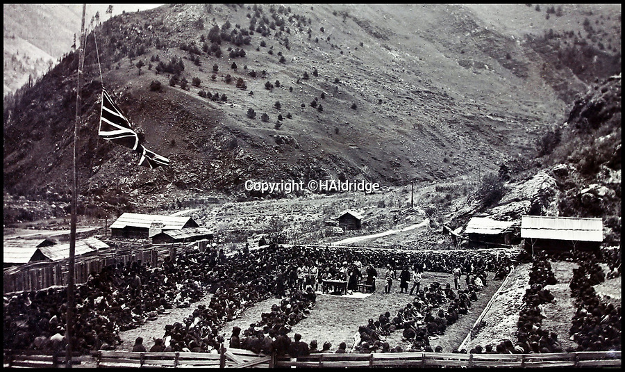 BNPS.co.uk (01202 558833)Pic: HAldridge/BNPS<br /> <br /> Distributing alms at Chumbi.<br /> <br /> Game tales from the hills...remarkable album shows British attempts to win over newly invaded Tibet by playing sport's straight from the playing fields of England.<br /> <br /> A collection of photos have come to light which show the people of the remote Himalayan nation of Tibet embracing one of the traditional British pastimes - a sports day.<br /> <br /> The archive of more than 500 photos was collated by a British Lieutenant Colonel, R C MacGregor, of the Indian Medical Service, who was present in Tibet between 1904 and 1912.<br /> <br /> These photos are one of the earliest examples of the British attempting to win 'the hearts and minds' of a native population as they were taken during the controversial Younghusband expedition to the distant Buddhist country.<br /> <br /> The archive also features four never before seen photos of the Dalai Lama returning to Tibet in 1912 after his exile ended.