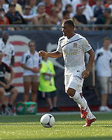C.D. Olimpia midfielder Carlos Will Mejia (7) dribbles down the wing. In an international friendly, AC Milan defeated C.D. Olimpia, 3-1, at Gillette Stadium on August 4, 2012.