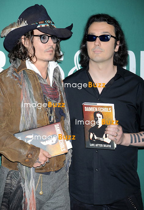 """Johnny Depp  & Damien Echols at a signing for """"Life After Death"""". at Barnes & Noble store in New York City. September 21, 2012."""
