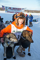 First place winner, Kevin Harper poses with his lead dgos at the finish line of the 2016 Junior Iditarod in Willow, Alaska, AK  February 28, 2016