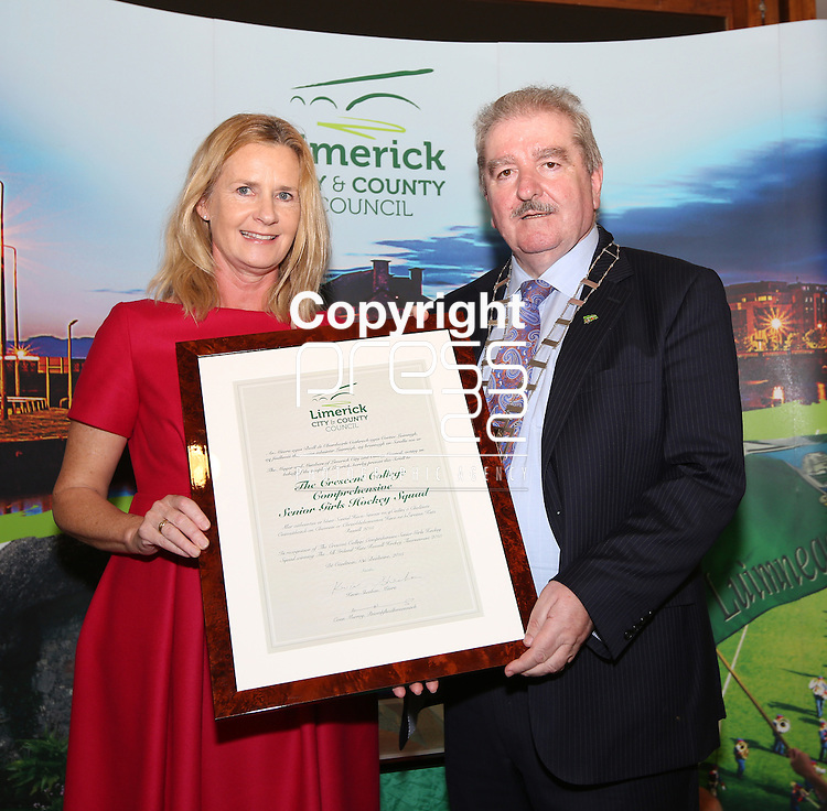 With compliments.  A Civic Reception on Wednesday evening last in the Council Chamber, Dooradoyle to honour the following  : The Irish Red Cross Limerick Area celebrating seventy five years of volunteer service to the people of Limerick City and County. The Under 20's Team 2014/2015 The Limerick Lakers Basketball Club in recognition of the Club winning The Cork County Cup, The Cork League Cup and The Cork League Top Four Playoff Cup and The Crescent College Comprehensive Senior Girls Hockey Squad in recognition of the Squad winning The All Ireland Kate Russell Hockey Tournament 2015.  Photographed at the event were the Mayor of Limerick Cllr Kevin Sheahan presenting the Parchment to Karin Fleming, principal Crescent College.       Photograph Liam Burke/Press 22