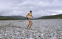 26 JUN 2002 - KHOVSGOL, MONGOLIA - Robert Alnebring crosses a dried up a river bed during the Mongolia Sunrise to Sunset Ultramarathon. (PHOTO (C) NIGEL FARROW)