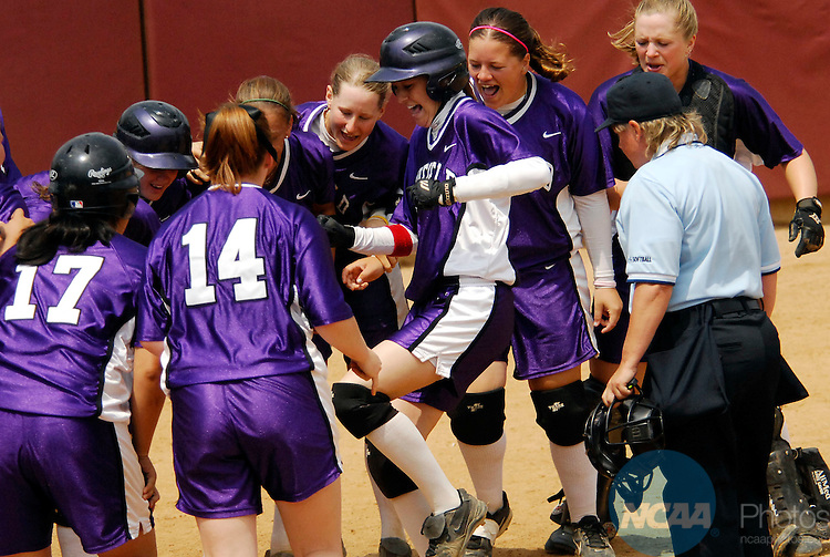 22 MAY 2007:  Teammates congratulate Lisa Smith (2) of Linfield College after her solo homerun during the Division III Women's Softball Championship held at the James I. Moyer Sports Complex in Salem, VA.  Linfield defeated Washington University (St. Louis) 10-2 for the national title.  Don Peterson/NCAA Photos