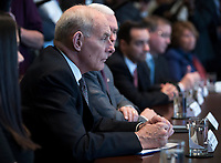 Secretary of Homeland John Kelly listens as US President Donald J. Trump delivers remarks during an opioid and drug abuse listening session in the Roosevelt Room of the White House in Washington, DC, USA, 29 March 2017. Photo Credit: Shawn Thew/CNP/AdMedia