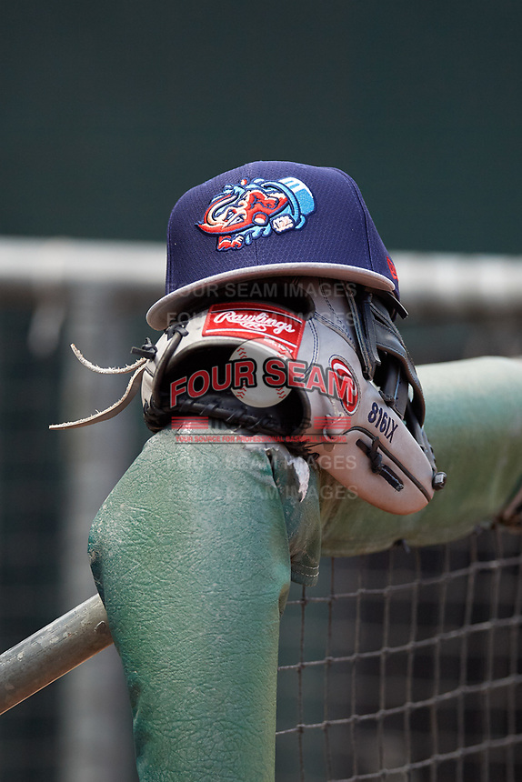 A Jacksonville Jumbo Shrimp hat rests on a glove during batting practice before a game against the Mobile BayBears on April 14, 2018 at Baseball Grounds of Jacksonville in Jacksonville, Florida.  Mobile defeated Jacksonville 13-3.  (Mike Janes/Four Seam Images)