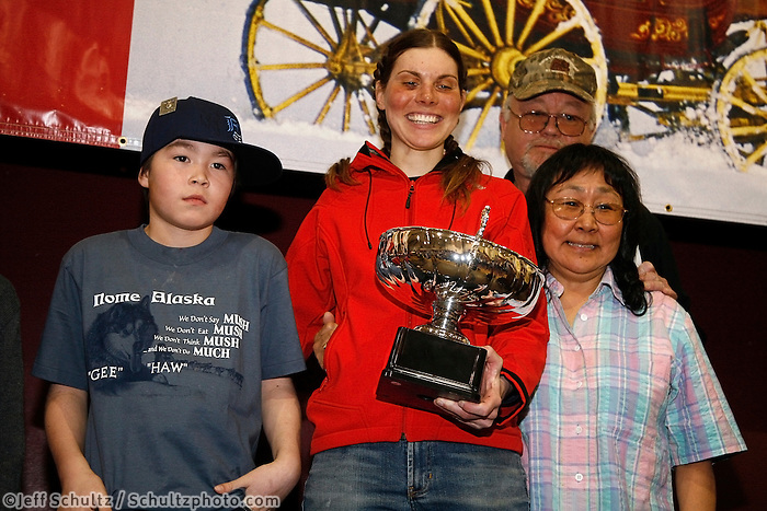 Sigrid Ekran recieves the rookie of the year award from Clara and Jerry Austin and their grandson at the Nome awards banquet.