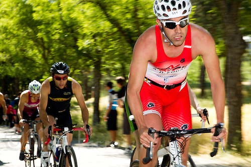 27 MAY 2012 - MADRID, ESP - Ruben Queiruga Mella (A.D Fogar) (men 30-34) on the bike during the  Spanish Men's National Sprint Distance Championship qualifying race at Casa de Campo in Madrid, Spain (PHOTO (C) 2012 NIGEL FARROW)