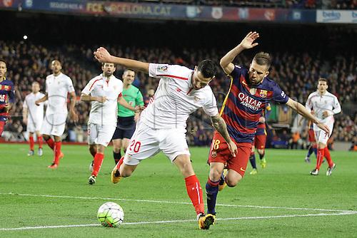28.02.2016. Nou Camp, Barcelona, Spain. La Liga football match. Barcelona versus Sevilla. Vitolo of Sevilla  challenged by Jordi Alba
