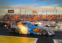 May 31, 2013; Englishtown, NJ, USA: NHRA funny car driver Chad Head (near lane) races alongside Bob Tasca III during qualifying for the Summer Nationals at Raceway Park. Mandatory Credit: Mark J. Rebilas-