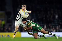 Elliot Daly of Wasps is tackled by Ofisa Treviranus of London Irish. Aviva Premiership match, between London Irish and Wasps on November 28, 2015 at Twickenham Stadium in London, England. Photo by: Patrick Khachfe / JMP