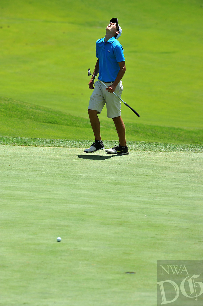 NWA Media/Michael Woods --06/24/2014-- w @NWAMICHAELW...Jackson Marseilles from Harrison,  reacts as his putt stops short of the hole Tuesday morning during the ASGA Stroke Play tournament at Shadow Valley Country Club in Rogers.