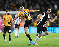 Wolverhampton Wanderers' Romain Saiss stretches for the ball under pressure from  Newcastle United's Andy Carroll <br /> <br /> Photographer Lee Parker/CameraSport<br /> <br /> The Premier League - Wolverhampton Wanderers v Newcastle United - Saturday 11th January 2020 - Molineux - Wolverhampton<br /> <br /> World Copyright © 2020 CameraSport. All rights reserved. 43 Linden Ave. Countesthorpe. Leicester. England. LE8 5PG - Tel: +44 (0) 116 277 4147 - admin@camerasport.com - www.camerasport.com