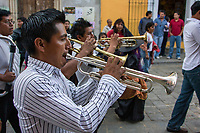 Oaxaca, Mexico, North America.  Day of the Dead Celebrations.  Trumpet Players in a parade.