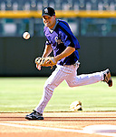 24 August 2007:  Colorado Rockies infielder Jamey Carroll warms up prior to a game against the Washington Nationals at Coors Field in Denver, Colorado. The Rockies rallied with 5 runs in the bottom of the 9th inning to defeat the Nationals 6-5 in the first game of their 3-game series...Mandatory Photo Credit: Ed Wolfstein Photo
