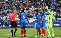 Referee Davide Massa shows Raphael Varane (4) (Real Madrid) of France a red card for a challenge on Dele Alli (Tottenham Hotspur) of England during the International Friendly match between France and England at Stade de France, Paris, France on 13 June 2017. Photo by David Horn/PRiME Media Images.