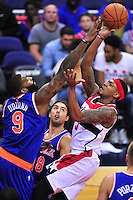 Bradley Beal of the Wizards shoots against a defender. New York defeated Washington 115-104 during a NBA preseason game at the Verizon Center in Washington, D.C. on Friday, October 9, 2015.  Alan P. Santos/DC Sports Box