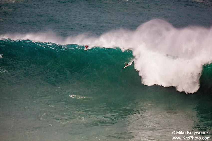 Surfer riding a wave at the 2016 Big Wave Eddie Aikau Contest, Waimea Bay, North Shore, Oahu