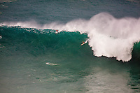 Surfer riding a wave at the 2016 Big Wave Eddie Aikau Contest, Waimea Bay, North Shore, Oahu