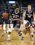Utah State's JoJo McGlaston (24) drives past Nevada defender Eric Cooper (21) during an NCAA college basketball game in Reno, Nev., on Tuesday, Jan. 20, 2015. (AP Photo/Cathleen Allison)