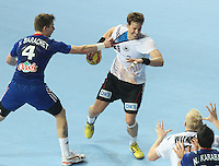 18.01.2013 Barcelona, Spain. IHF men's world championship, prelimanary round. Picture show Sven-Sören Christophersen  in action during game between France vs Germany at Palau St Jordi