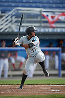 West Virginia Black Bears shortstop Nick King (12) at bat in the rain during a game against the Batavia Muckdogs on June 25, 2017 at Dwyer Stadium in Batavia, New York.  Batavia defeated West Virginia 4-1 in nine innings of a scheduled seven inning game.  (Mike Janes/Four Seam Images)