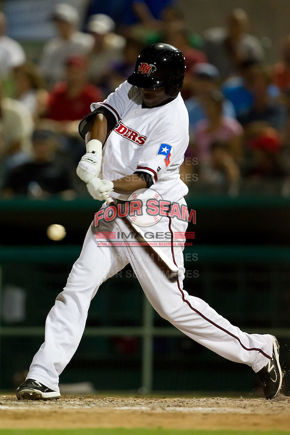 Jose Ruiz (50) of the Frisco RoughRiders makes contact on a pitch during a game against the North All-Stars 2011 in the Texas League All-Star game at Nelson Wolff Stadium on June 29, 2011 in San Antonio, Texas. (David Welker / Four Seam Images)..