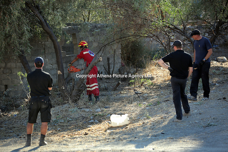 FAO JANET TOMLINSON, DAILY MAIL PICTURE DESK<br /> Pictured: Special forensics police officers and a Red Cross worker fell a tree after to make space for a further search by a disused building in a field in Kos, Greece. Saturday 01 October 2016<br /> Re: Police teams led by South Yorkshire Police, searching for missing toddler Ben Needham on the Greek island of Kos have moved to a new area in the field they are searching.<br /> Ben, from Sheffield, was 21 months old when he disappeared on 24 July 1991 during a family holiday.<br /> Digging has begun at a new site after a fresh line of inquiry suggested he could have been crushed by a digger.