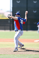 Brandon Webb #33 of the Texas Rangers pitches in an extended spring training game against the Seattle Mariners at the Mariners complex on April 30, 2011  in Peoria, Arizona. Webb, who has not pitched in the major leagues since April 2009, is attempting to rehabilitate an injured shoulder..Photo by:  Bill Mitchell/Four Seam Images.