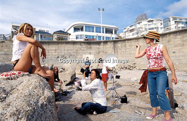 digefas00019 Beauty. A swimsuit fashion shoot for Elle Magazine at Bantry Bay beach in Cape Town , South Africa on August 21, 2002..©Per-Anders Pettersson/ iAfrika Photos