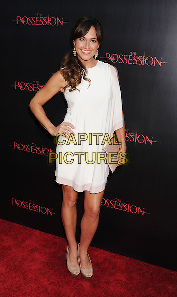 "Nikki DeLoach.""The Possession"" Los Angeles Premiere held at Arclight Cinemas, Hollywood, California, USA..August 28th, 2012.full length dress hand on hip white sleeveless pink beige clutch bag.CAP/ROT/TM.©Tony Michaels/Roth Stock/Capital Pictures"