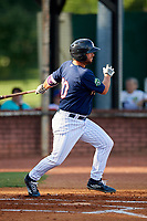 Elizabethton Twins first baseman Chris Williams (40) follows through on a swing during a game against the Bristol Pirates on July 28, 2018 at Joe O'Brien Field in Elizabethton, Tennessee.  Elizabethton defeated Bristol 5-0.  (Mike Janes/Four Seam Images)