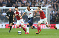 Arsenal's Sokratis Papastathopoulos and GranitXhaka chase Tottenham Hotspur's Harry Kane<br /> <br /> Photographer Rob Newell/CameraSport<br /> <br /> The Premier League - Tottenham Hotspur v Arsenal - Saturday 2nd March 2019 - Wembley Stadium - London<br /> <br /> World Copyright © 2019 CameraSport. All rights reserved. 43 Linden Ave. Countesthorpe. Leicester. England. LE8 5PG - Tel: +44 (0) 116 277 4147 - admin@camerasport.com - www.camerasport.com