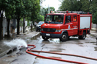 Pictured: A fire service vehicle helps drain water from properties in the Chalandri suburb of Athens, Greece. Sunday 29 July 2018<br /> Re: Flash-flooding after heavy rainfall in parts of Athens, Greece.