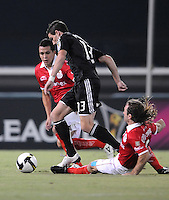 DC United  forward Chris Pontius (13) gets fouled by Toluca FC midfielder Martin Romagnoli (5)  Toluca FC defeated DC United 3-1in the Concacaf Champions League tournament,at RFK Stadium Wednesday, August 26  2009.