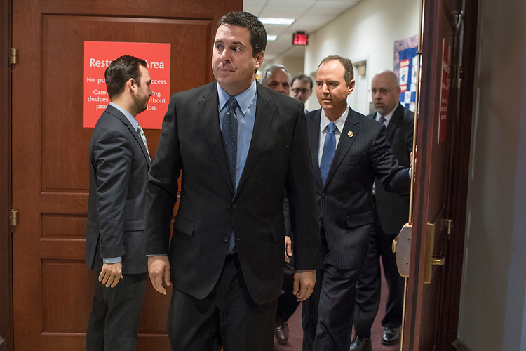 UNITED STATES - MARCH 15: Chairman of the House Permanent Select Committee on Intelligence Devin Nunes, R-Calif., and Rep. Adam Schiff, D-Calif., ranking member, right, arrive for a news conference in the Capitol Visitor Center where they addressed President Trump's wiretapping accusation and other matters, March 15, 2017. (Photo By Tom Williams/CQ Roll Call)