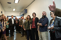 A group listens to Warden Edward Thomas talk about Central Prison during a tour in Raleigh, NC on Thursday, November 17, 2016. (Justin Cook)