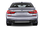 Straight rear view of a 2018 BMW 7 Series M760 Li 4 Door Sedan stock images