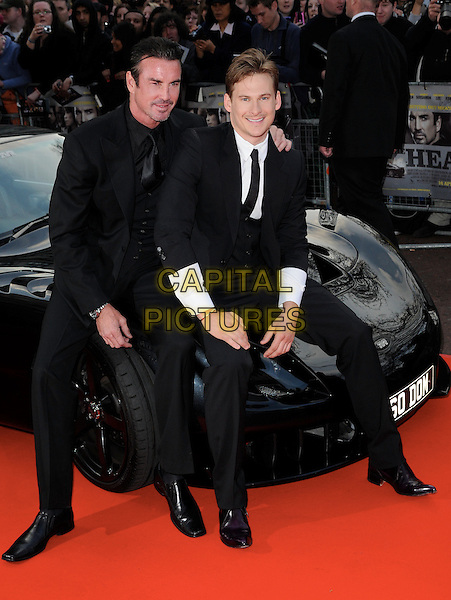 "GARY STRETCH & LEE RYAN .At the UK film premiere of ""The Heavy"", Odeon West End cinema, Leicester Square, London, England, UK, .April 15th 2010..arrivals full length black suit tie sitting on car bonnet arm around shoulder smiling white shirt .CAP/CAN.©Can Nguyen/Capital Pictures."