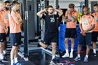 Sports scientist, Jordan Smith (C) shows a training exercise to players during the Swansea City Training Session at The Fairwood Training Ground, Wales, UK. Tuesday 03 July 2018