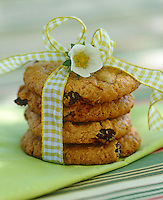 A pile of homemade cookies tied with a gingham ribbon for a children's party