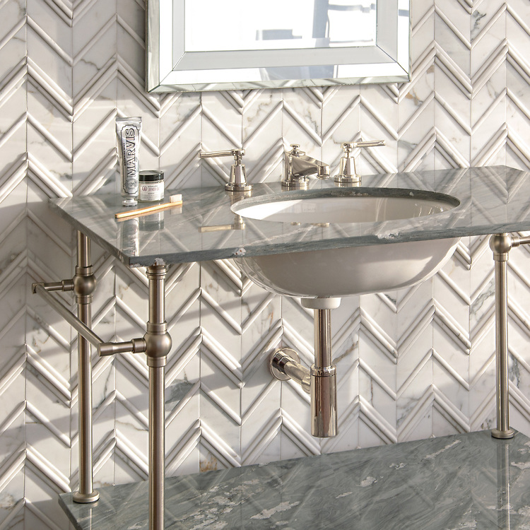 Thomas, a hand-cut stone mosaic, shown in venetian honed and honed Calacatta Tia, is part of the Tissé® collection for New Ravenna.