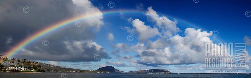 Rainbow over southeast O'ahu with Koko Head and Koko Crater at the horizon