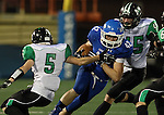 SIOUX FALLS, SD - OCTOBER 23: Keegan VanEgdom #42 from Sioux Falls Christian looks for room between Joe Hanson #5 and Will Gottlob #45 from McCook Central Montrose in the first half of their game Thursday night at Bob Young Field. (Photo by Dave Eggen/Inertia)
