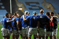 The Bath Rugby forwards huddle together during the pre-match warm-up. European Rugby Champions Cup match, between Wasps and Bath Rugby on December 13, 2015 at the Ricoh Arena in Coventry, England. Photo by: Patrick Khachfe / Onside Images