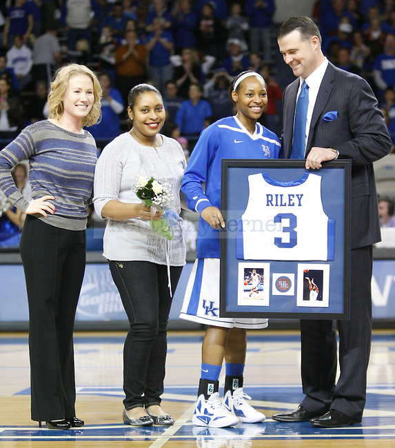 UK Hoops Head Coach Matthew Mitchell presents senior point guard Crystal Riley a framed jersey during the first half of UK Hoops senior night game vs. South Carolina at Memorial Coliseum in Lexington, Ky., on Thursday, Feb. 23, 2012. Photo by Tessa Lighty | Staff