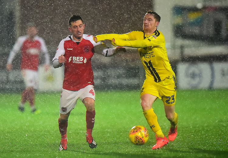Fleetwood Town's Jason Holt vies for possession with Burton Albion Stephen Quinn<br /> <br /> Photographer Richard Martin-Roberts/CameraSport<br /> <br /> The EFL Sky Bet League One - Saturday 15th December 2018 - Fleetwood Town v Burton Albion - Highbury Stadium - Fleetwood<br /> <br /> World Copyright © 2018 CameraSport. All rights reserved. 43 Linden Ave. Countesthorpe. Leicester. England. LE8 5PG - Tel: +44 (0) 116 277 4147 - admin@camerasport.com - www.camerasport.com